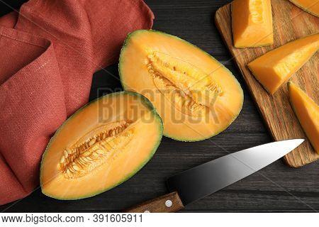 Tasty Fresh Cut Melon On Black Wooden Table, Flat Lay