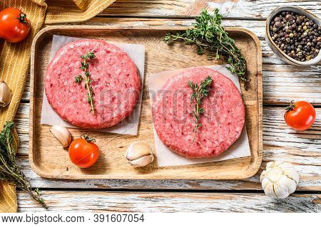Raw Burger Patties. Mince Meat Cutlet, Ground Beef And Pork. White Background. Top View.
