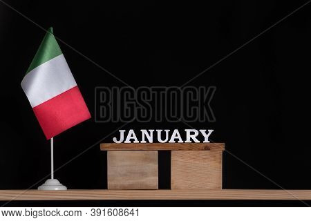 Wooden Calendar Of January With Italian Flag On Black Background. Dates In Italy In January.