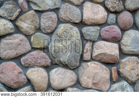 Natural Big Textured Stone. Fragment Of A Colored Stonewall. Background.