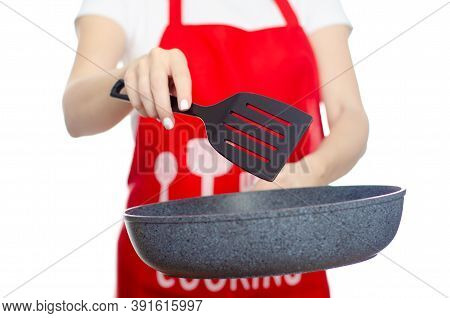 Woman In Apron Cook Holding Pan With Kitchen Spatula In Hand On White Background Isolation