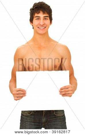 Smiling young man with tanned muscular naked torso holding a blank form.