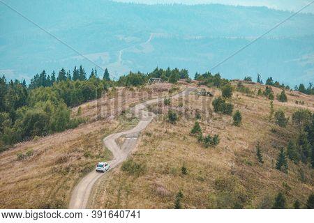Off Road Car Travel By Mountains Peak Autumn Season