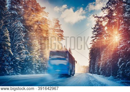 Bus On Asphalt Road In Beautiful Winter Day At Countryside
