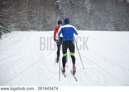 Skier Skiing In The Snow. Cross Country Skilling.