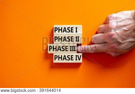 Time To Phase 3. Wooden Blocks Form The Words 'phase, 1, 2, 3, 4' On Orange Background. Male Hand. B