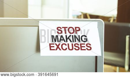 Sticky Note On The Computer. Text Stop Making Excuses
