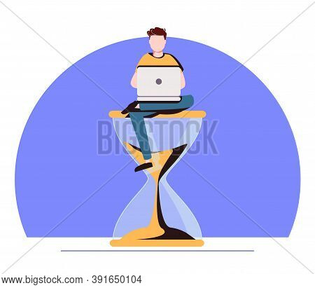 Procrastination In Business Process Concept. Businessman Sitting On Hourglass With Laptop In Hands.