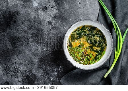 Miso Soup With Tofu And Seaweed. Black Background. Top View. Copy Space
