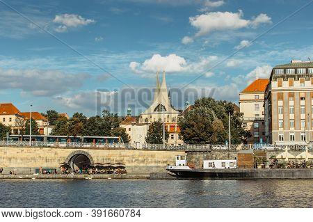 Prague,czech Republic-september 3,2020. Postcard View Of Rasin Embankment And Emauzy Monastery.river