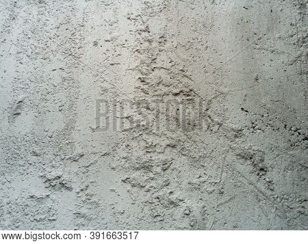 Cement Board Background And Texture. Unevenly Set Cement. Rough Gray Concrete Wall.
