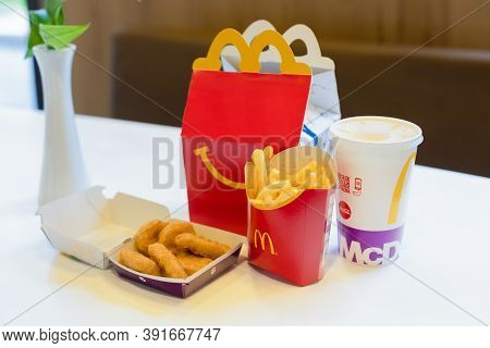 Happy Meal Menu At Mcdonalds Restaurant. Happy Meal Kids Next To Cheeseburger, Drink And Chicken Mcn