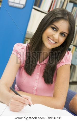 Woman Sitting In Library Studying