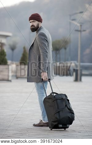 Carry Travel Bag. Man Bearded Hipster Travel With Luggage Bag On Wheels. Adjust Living In New City.