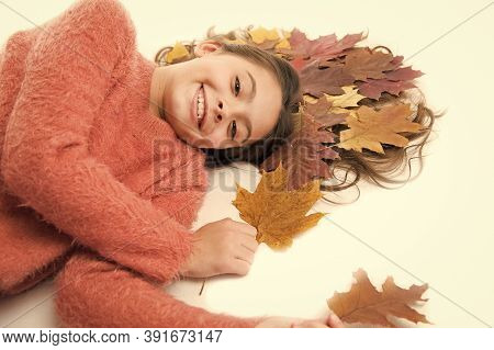 Little Girl Gorgeous Long Hair And Fallen Maple Leaves Lay On White Background. Deep Conditioning Tr