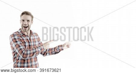 Attracting Attention. Happy Man Pointing At Isolated On White. Handsome Guy With Pointing Gesture. I