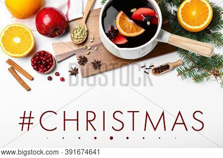 Hashtag Christmas, Delicious Mulled Wine And Ingredients On White Background, Flat Lay