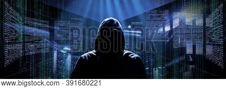 Anonymous Internet Hacker In Front Of Computer. Web Crime Concept
