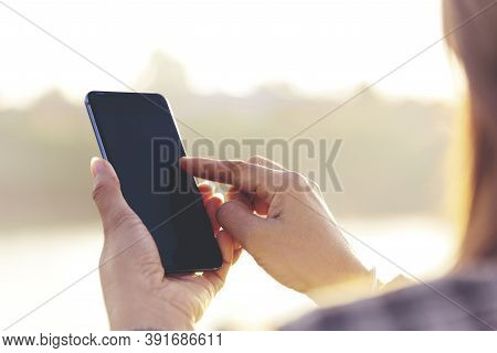 Woman Hands Holding Mobile Phone Outdoor Surfing Internet Online Technology Lifestyle. Close Up Woma