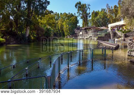 The place of symbolic baptism is equipped with walkways and partitions. Yardenit, Israel. The exit of the Jordan River from Lake Galilee. Religious, ethnographic and photo tourism concept