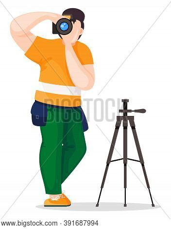 Photographer Or Paparazzi With Small Bag Taking Photo With High Resolution Camera Near Tripod. Photo
