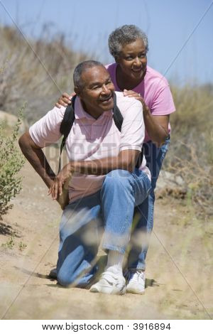 Senior Couple On A Walking Trail