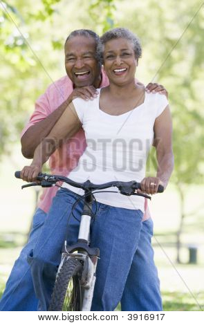 Senior couple on a bicycle poster