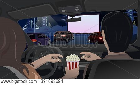 Man And Woman Are Eating Popcorn In The Car And Watching A Movie On A Big Screen In A Car Cinema. Ev