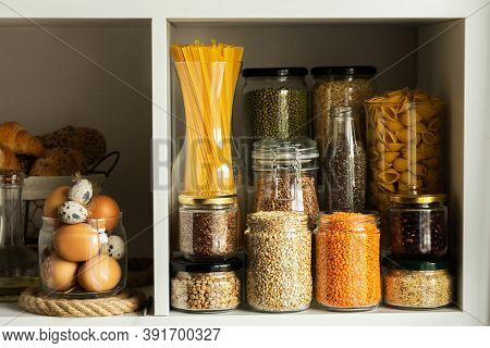 Glass jars with food.Food concept.Shelves in the kitchen.Products on the shelves.Jars of cereals(buc