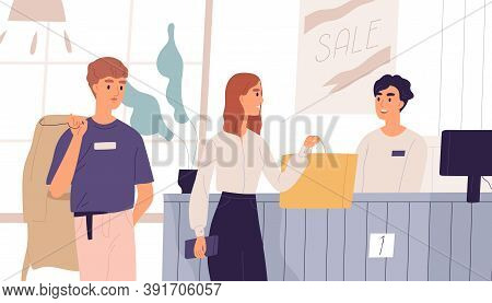 Young People In Outlet Shop Purchasing Clothes. Cashier At Checkout Counter And Customers Standing I
