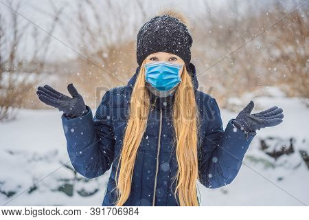 The Woman Wearing A Medical Mask During Covid-19 Coronavirus Was Very Froze In Winter Under Snowfall