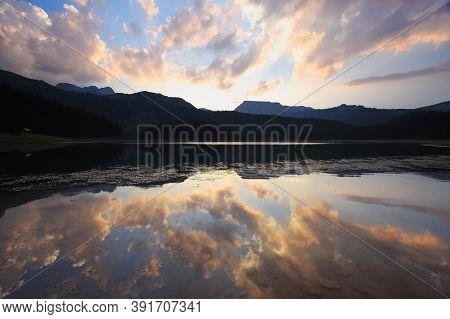 Beautiful Sunset With Reflection On Black Lake,durmitor Mountain,montenegro