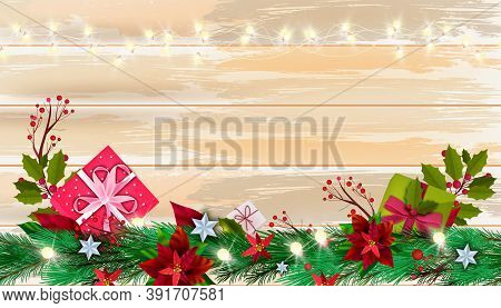 Christmas Winter Poinsettia Background With Gift Boxes, Fir Branch, Berries On Wooden Table Surface.