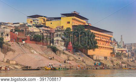 Varanasi, India - November 07, 2019: Colorful Buildings At The Ganges River In Varanasi, India