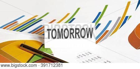 Tomorrow Text On Paper On The Chart Background With Pen