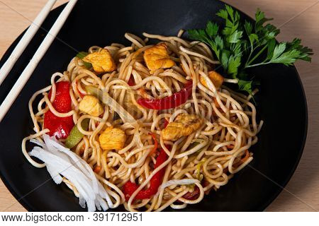 Asian Food, Fried Yakisoba Noodles With Chicken. Isolated Image.