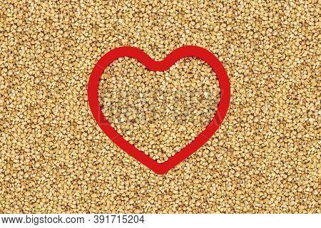Green Buckwheat Groats In Heart Shape Red Frame.