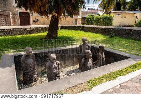 Stone Town, Zanzibar, 28/09/18. Memory For The Slaves By Clara Sornas - Art Installation Of Life-siz