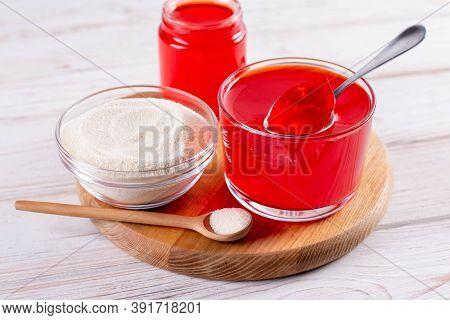 Gelatin, Agar-agar, Gelatinous Mass On A Cutting Board. Gelling Agent For Culinary, Confectionery Pr