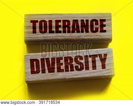 Tolerance Diversity Words On Wooden Blocks On Yellow. Equality Concept By Gender, Ethnicity And Age