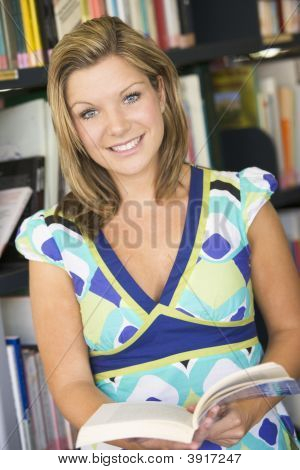 Student In Library Holding Book (Selective Focus)