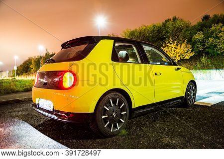 Prague, Czech Republic - October 26, 2020. Night Photo Of Back Side Of Electric Honda E With Interio