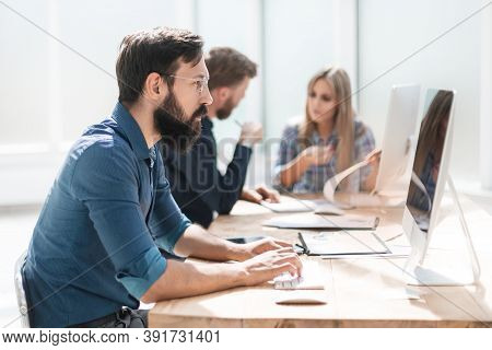 Businessman And A Group Of Employees Working In The Office.