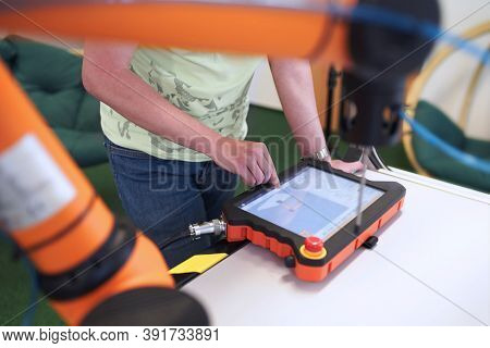 Man In Factory With Robotic Arm And Touch Panel, Robotic Hand Programming