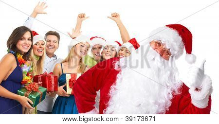 Santa claus and a group  of happy people. Christmas party.