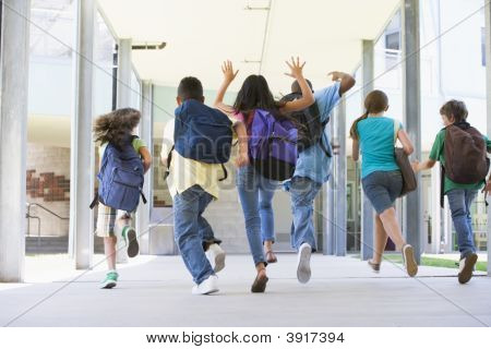 Six students running to front door of school excited poster