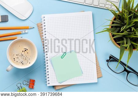 Business desk workplace and office objects over blue backdrop. Top view flat lay with copy space for your text