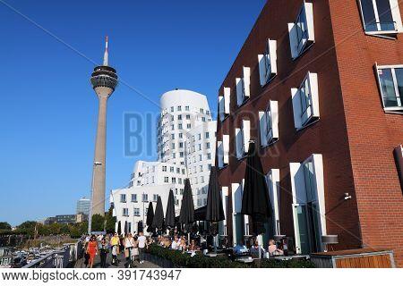 Dusseldorf, Germany - September 19, 2020: People Walk By Neuer Zollhof Buildings In Dusseldorf, Germ