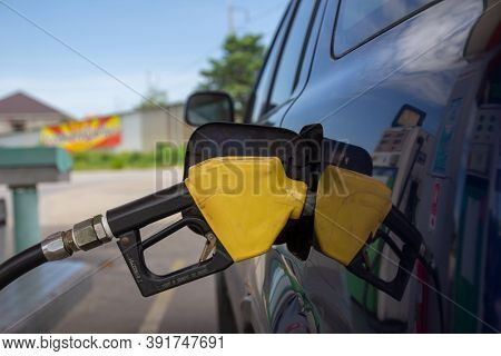 Car Gas Nozzle Auto Filling Refuel Fill Up With Premium Petrol Gasoline At Gas Station, Close Up.  G
