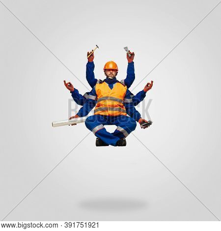 Handsome Contractor, Multi-armed Builder Levitating Isolated On Grey Studio Background With Equipmen